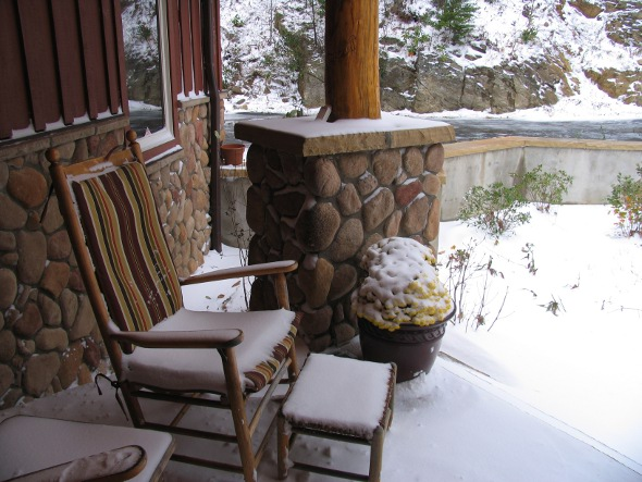 Photo of Snow Covered Porch of a Mountain Home